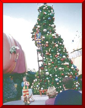 acrobats in front of whos' christmas tree